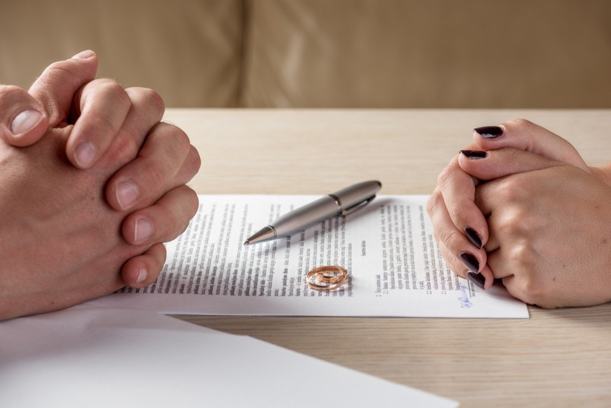Man and woman signing divorce papers